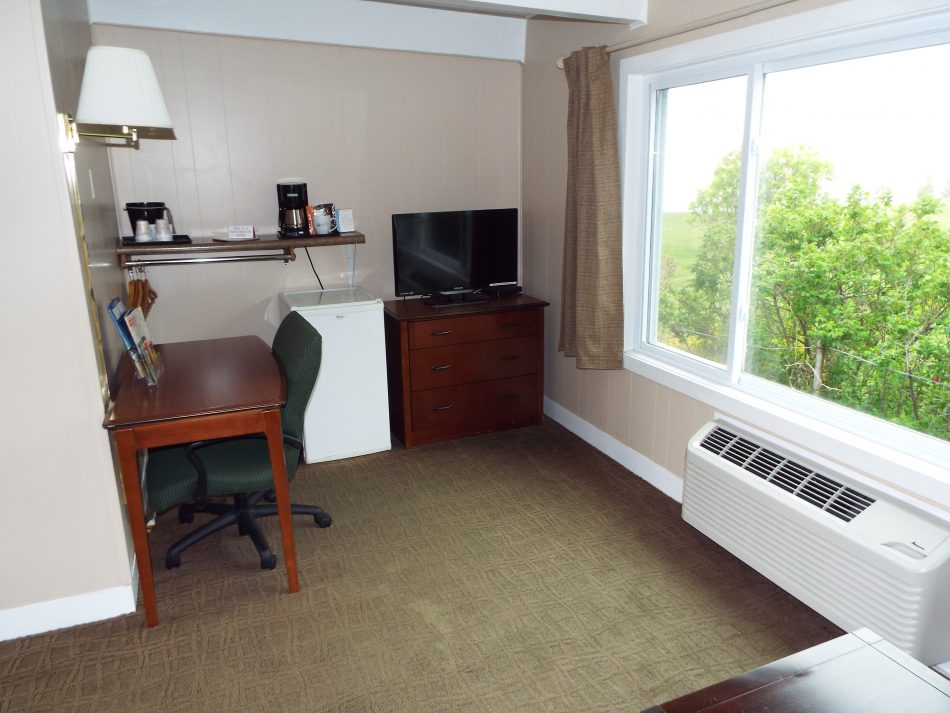 Room 112 desk and TV area