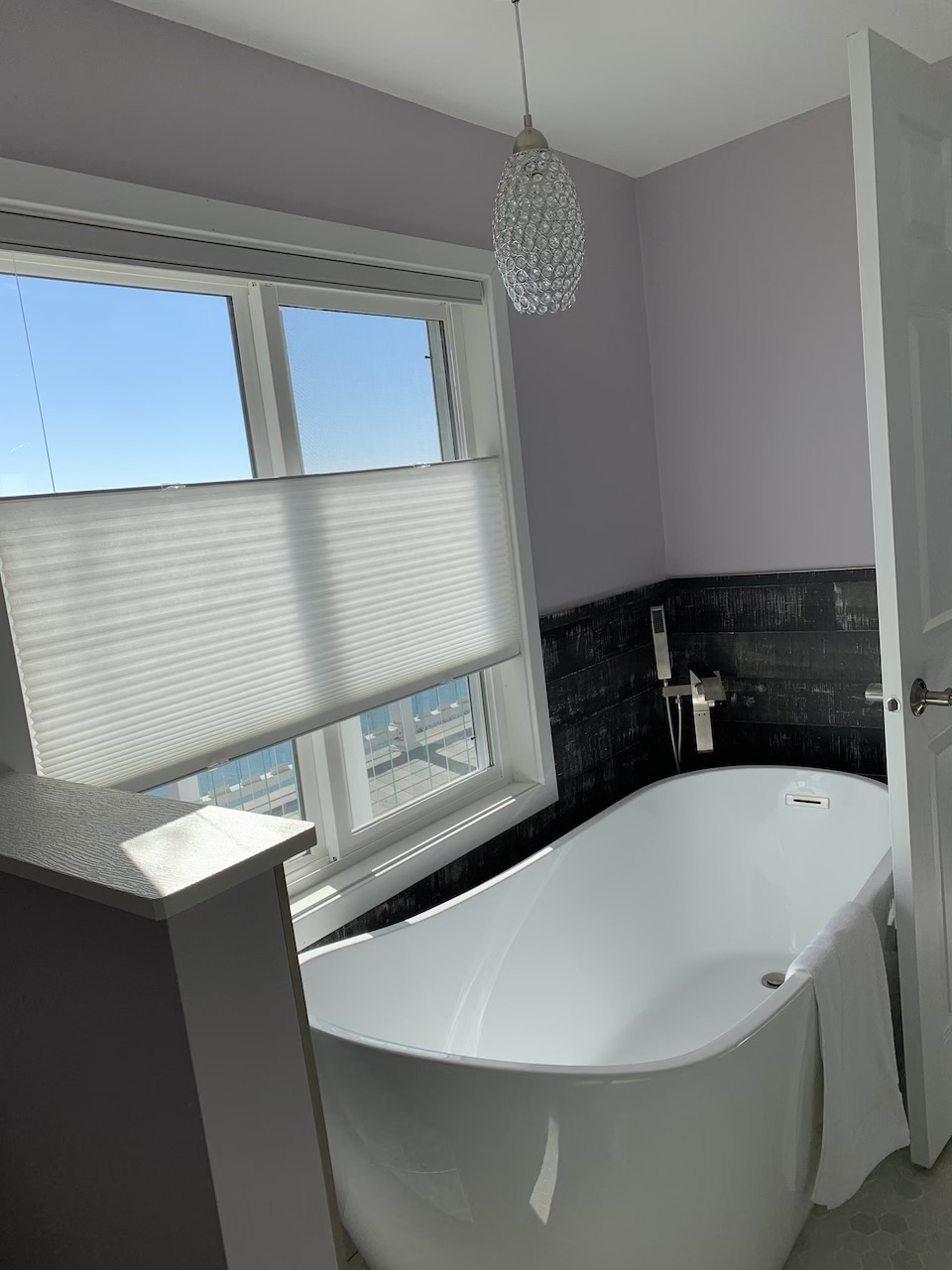 Our Beautiful soaker tub overlooking the beach. Enjoy a glass of wine while relaxing in the tub.
